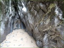 A cave in Hunts Bay Oolite Subgroup Carboniferous Limestone at South Beach in Tenby