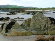 Striped rocky mudstone outcrops on the beach