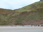 Old land slip area with boulders on the shore at Rhossili