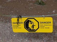 Warning sign of danger from falling rocks