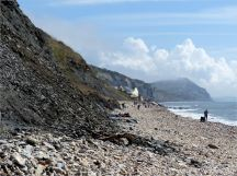 View of Charmouth Beach looking east towards the Heritage Centre and Golden Cap