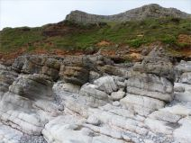 Weathered limestone rock layers on the Worms Head Causeway in Gower, South Wales.