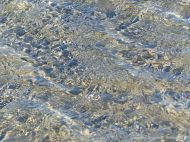 Water patterns on the beach at Rocquine Bay
