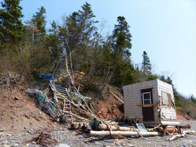 Beach hut near Wasson Bluff with red Jurassic McCoy Brook Formation rocks