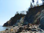 Cliffs and beach boulders at Clarke Head, Nova Scotia, Canada.
