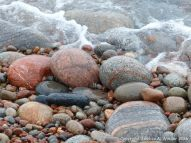 Pebbles at the water's edge in Pleasant Bay, cape Breton, NS.