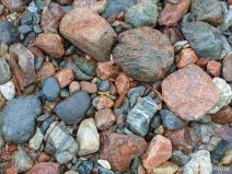 Ancient rocks of many types and colours on the river bed at Lone Shieling