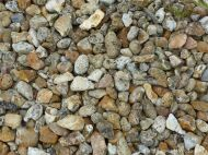 Flints and beach stones with holes on a shingle shore
