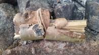 Split Cedar Bundled in Birch Bark left for next camper, Adirondack tradition. Added carved skull for fun.