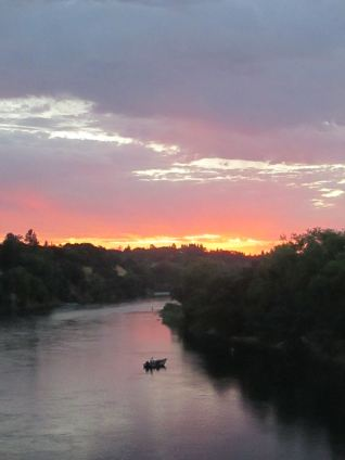fire in the sky, Fair Oaks Bridge, American River, morning, sunrise, writing, photo, nature, fisherman, boat, clouds