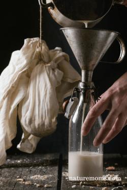 bottle of fresh almond milk