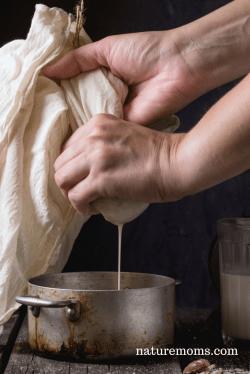 straining almonds for almond milk