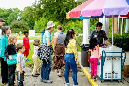 Conservation Easement Stewardship Specialist Nick Sanchez serves ice cream at the Highlands Community Celebration. Photo by M-Buck Studio.