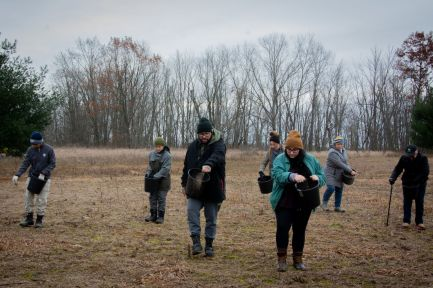 Volunteers seed an acre of prairie at Saul Lake Bog Nature Preserve.