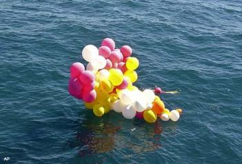Balloons found by rescuers searching for Father de Carli