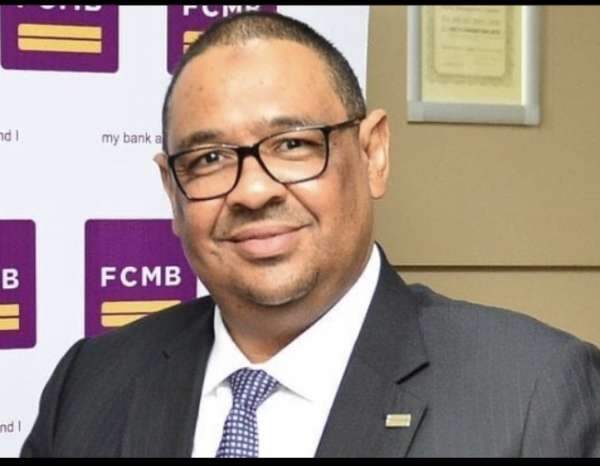 Wife of embattled FCMB MD stands with husband