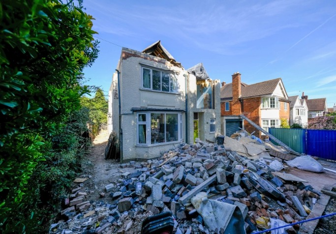 Furious builder destroys house he worked on 'after owner refused to pay him