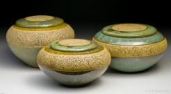 Church-keyed stoneware urns