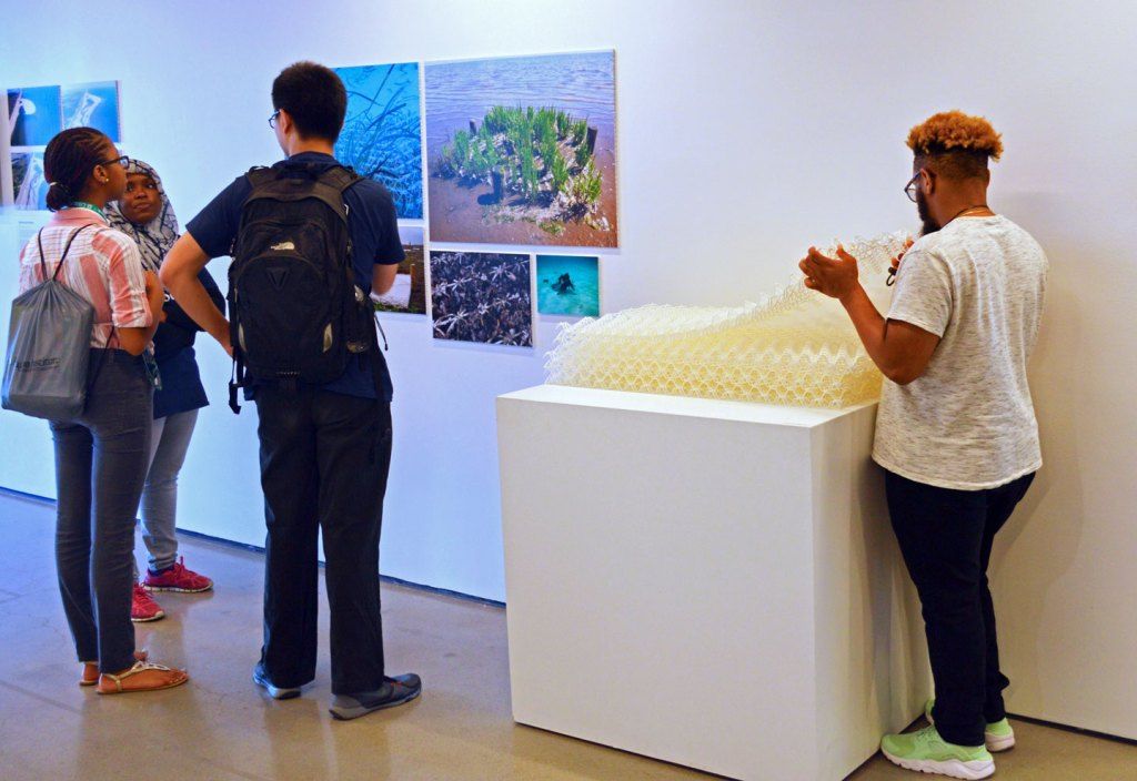 NatureStructure Exhibition visitors interacting with BESE-elements, foundations for near-shore ecosystems.