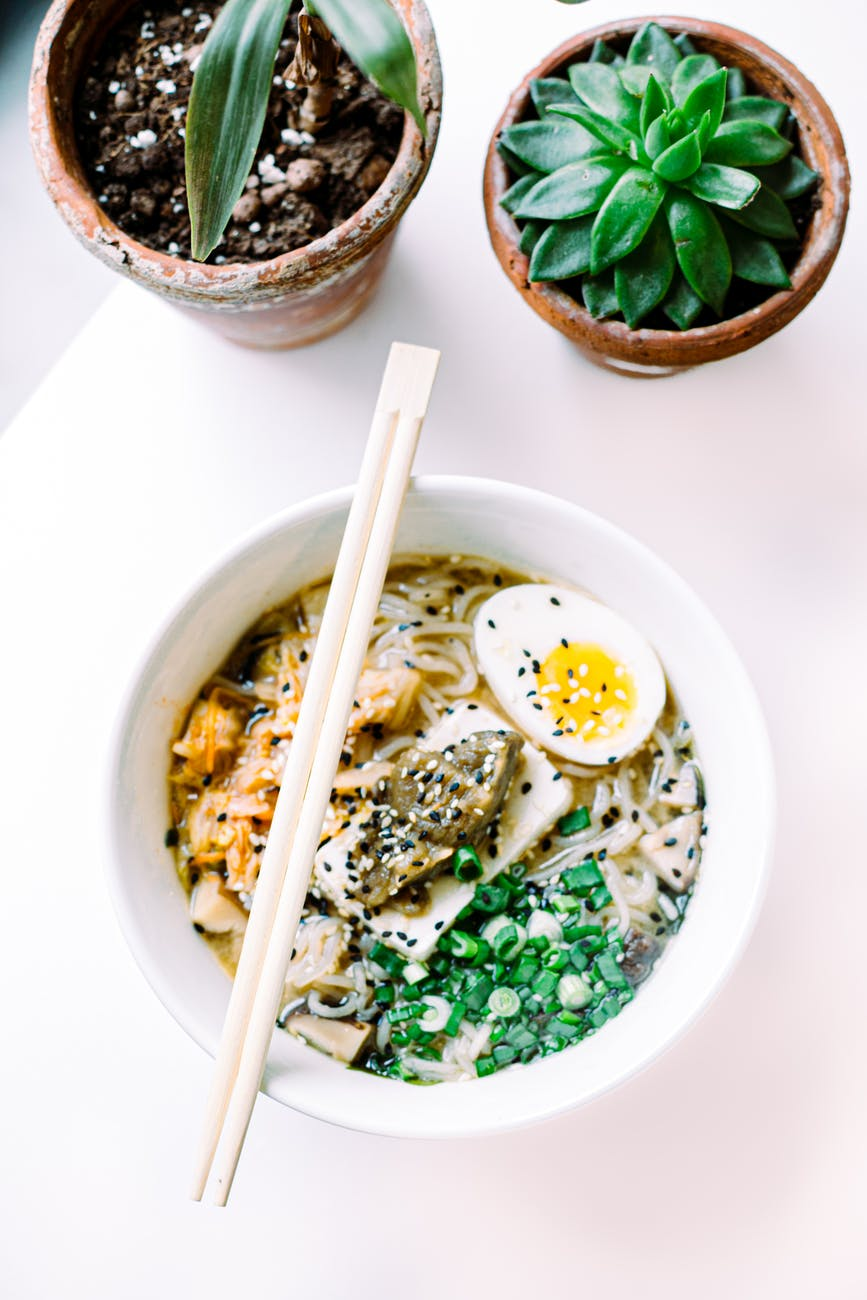 yummy asian soup with noodles and boiled egg