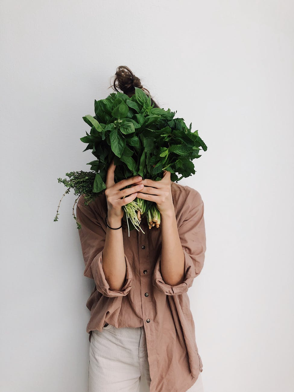 person holding green vegetables