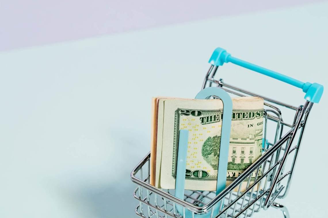 dollar bills in a cart