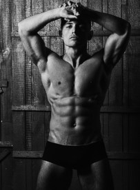Attractive charming muscular athlete man