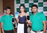 The gorgeous Tollywood celeb Ms Pragya Jaiswal unveiling the Selfie Expert OPPO F3 Plus, on Saturday at Lemon Tree Hotel, she is seen flanked by Mahesh, (extreme left) Product Manager & Sandeep, Communication Manager, OPPO Mobiles Telangana Pvt. Ltd.