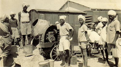 workers working on railway track khanewal punjab