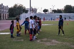 Coach trains children for under 14 football tournament.