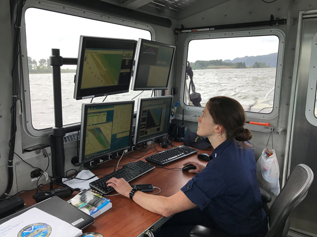 Lt. j.g. Shelley Devereaux monitors survey collection near Price Island on the Columbia River.
