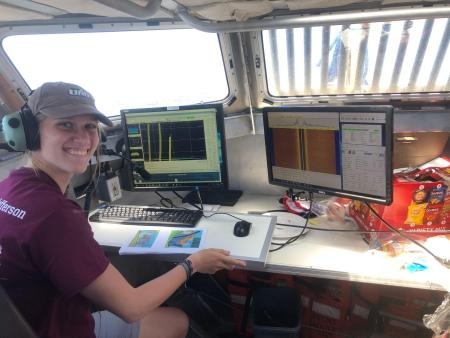 Learning to log data on the left monitor, and observing the side scan data collected on the right monitor as we pass over it. On a third monitor, not shown, is a map of the bay where the new lines are selected for the coxswain to follow.