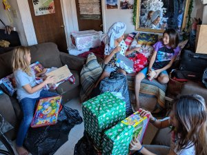 Young girls with family delivery gifts