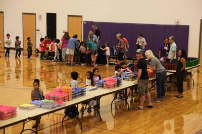 Elementary students picking out school supplies