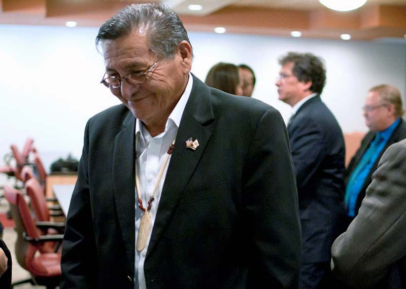 Navajo Nation President Ben Shelly smiles as he makes his way out of the Navajo Department of Transportation conference room on Saturday at the conclusion of the Navajo Nation Supreme Court hearing in Tse Bonito, N.M. (Times photo - Donovan Quintero)