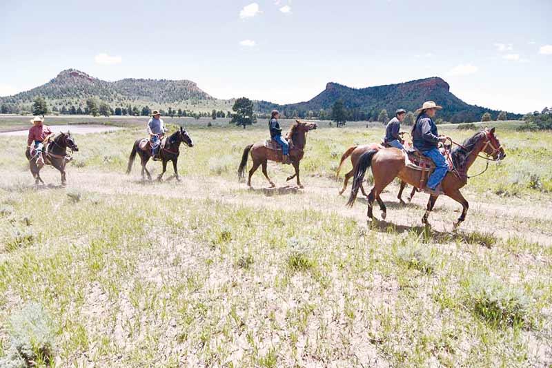 Riders on horseback against the Bears Ears