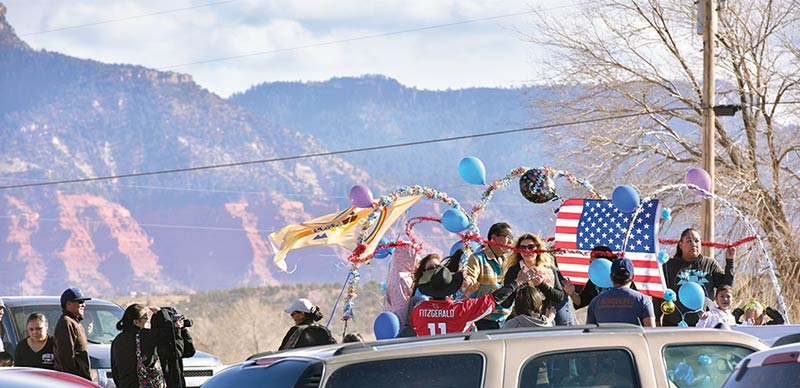 balloons adorn float amid sea of cars
