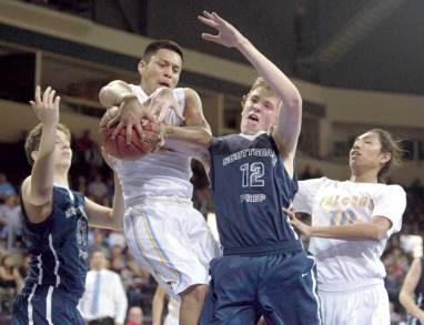 Navajo Times | Donovan Quintero Alchesay Falcon Tyreck Cosay and Scottsdale Prep's Alex Curry (12) fight for the loose ball Saturday at the Prescott Valley Events Center.