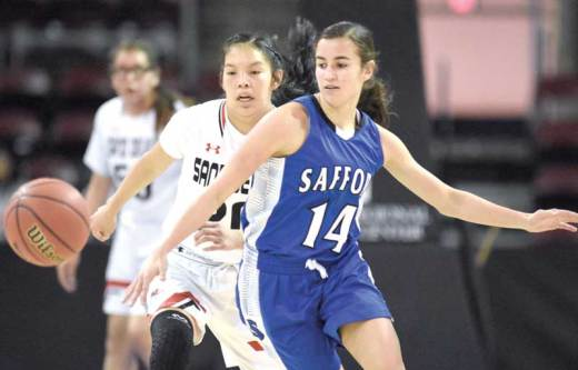 Navajo Times | Donovan Quintero Page's Myka Taliman, white jersey, and Safford's Deion Abalos (14) go after the ball Monday during the Arizona 3A girls state quarterfinals in Prescott Valley, Arizona.