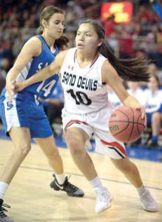 Navajo Times | Donovan Quintero Page Lady Sand Devil Mikala Benally (10) drives the ball against Lady Bulldog Deion Abalos (14) Monday during the Arizona 3A girls state quarterfinals in Prescott Valley, Arizona.