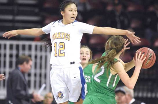 Navajo Times | Donovan Quintero Valley Lady Pirate Nizhoni James (12) reaches for the ball as she attempts to knock it away from a Thatcher Lady Eagle player Saturday in the Arizona 2A girls state quarterfinals at the Prescott Valley Events Center. Valley was defeated, 51-50.