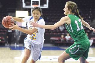 Navajo Times | Donovan Quintero Valley's Nizhoni James (12) powers her way to the basket and around a closely guarding Lady Eagle defender Saturday at the Prescott Valley Events Center in Prescott Valley, Arizona.