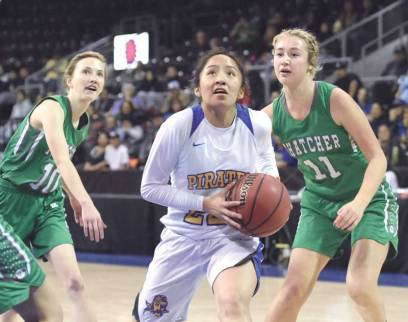 Navajo Times | Donovan Quintero Lady Pirate Codi Spencer gets by a pair of Lady Eagle defenders as she makes her way to the basket Saturday in Prescott Valley, Arizona.