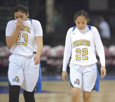 Navajo Times | Donovan Quintero Valley Lady Pirate teammates Tilda Hubbell (23) and Codi Spencer (22) walk off the basketball court as they contain their emotions after being knocked out the of the Arizona 2A girls state playoff picture Saturday in Prescott Valley, Arizona.