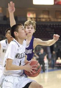 Navajo Times | Donovan Quintero Chinle's Curtis Begay takes the ball to the basket and gets by a Wickenburg player Tuesday in Prescott Valley, Arizona.