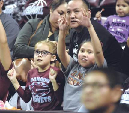 Navajo Times | Donovan Quintero Young Ganado Lady Hornet fans Jordan Claw, 7, left, and auntie Jasah McIntosh, 10, both from Ganado, Arizona, cheer on their team Monday evening at the Prescott Valley Events Center.