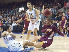 Navajo Times | Donovan Quintero Rock Point Lady Cougar Ranisha Begay (32) and Fort Thomas Lady Apaches Chesliauna Wilson and Kaitlynn Hinton (25) miss a chance to grab the ball Saturday in Prescott Valley, Arizona.