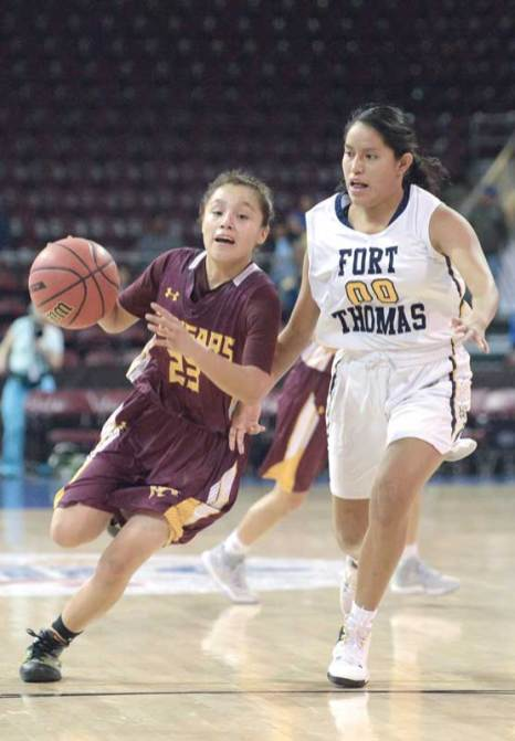 Navajo Times | Donovan Quintero Rock Point Lady Cougar Christin Bahe (23) drives the ball by Fort Thomas Lady Apache Normisha Moses (00) Saturday in the Arizona 1A girls state quarterfinals at the Prescott Valley Events Center in Prescott Valley, Arizona.