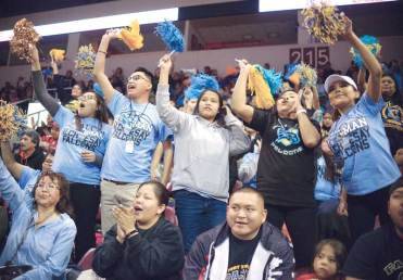 Navajo Times | Donovan Quintero Alchesay Falcons fans wave pompoms as they cheer for their team Feb. 23 during the state 1A boys' semifinals against the Paradise Honors Panthers in Prescott Valley, Ariz.