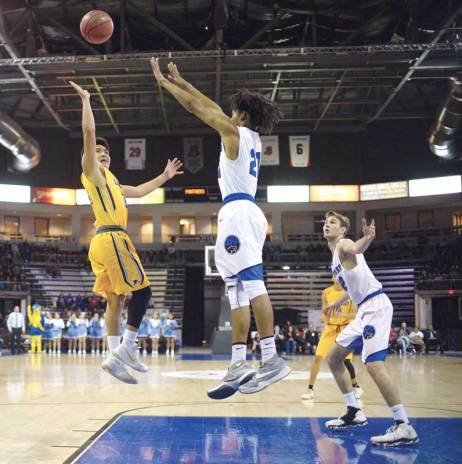 Navajo Times | Donovan Quintero Alchesay Falcon Tyreck Cosay, yellow jersey, shoots over a Paradise Honors player during the Arizona 2A boys semifinals on Feb. 24.